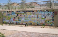 Full view of a 5x25 foot painted tile mural in a desert-friendly hospital courtyard
