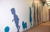 Various family members silhouetted against light gray wall