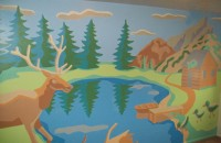 Mural of an elk by a lake