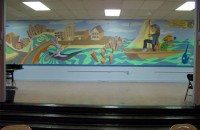 Colorful water-themed mural in school cafeteria.