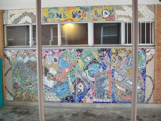 Mosaic mural on the side of a restaurant