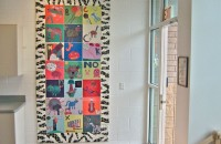 Alphabet tile mural of collages